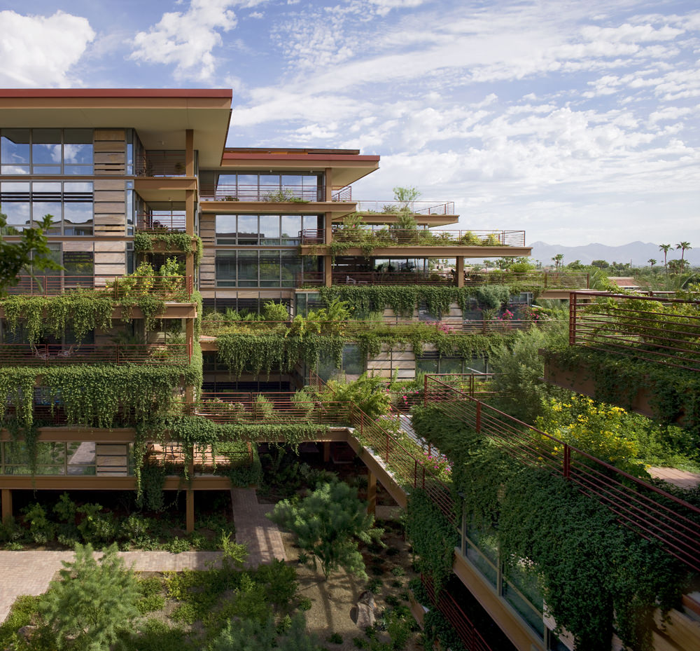 Optima Camelview Village from afar shows balconies lush with greenery and a view of the courtyard.