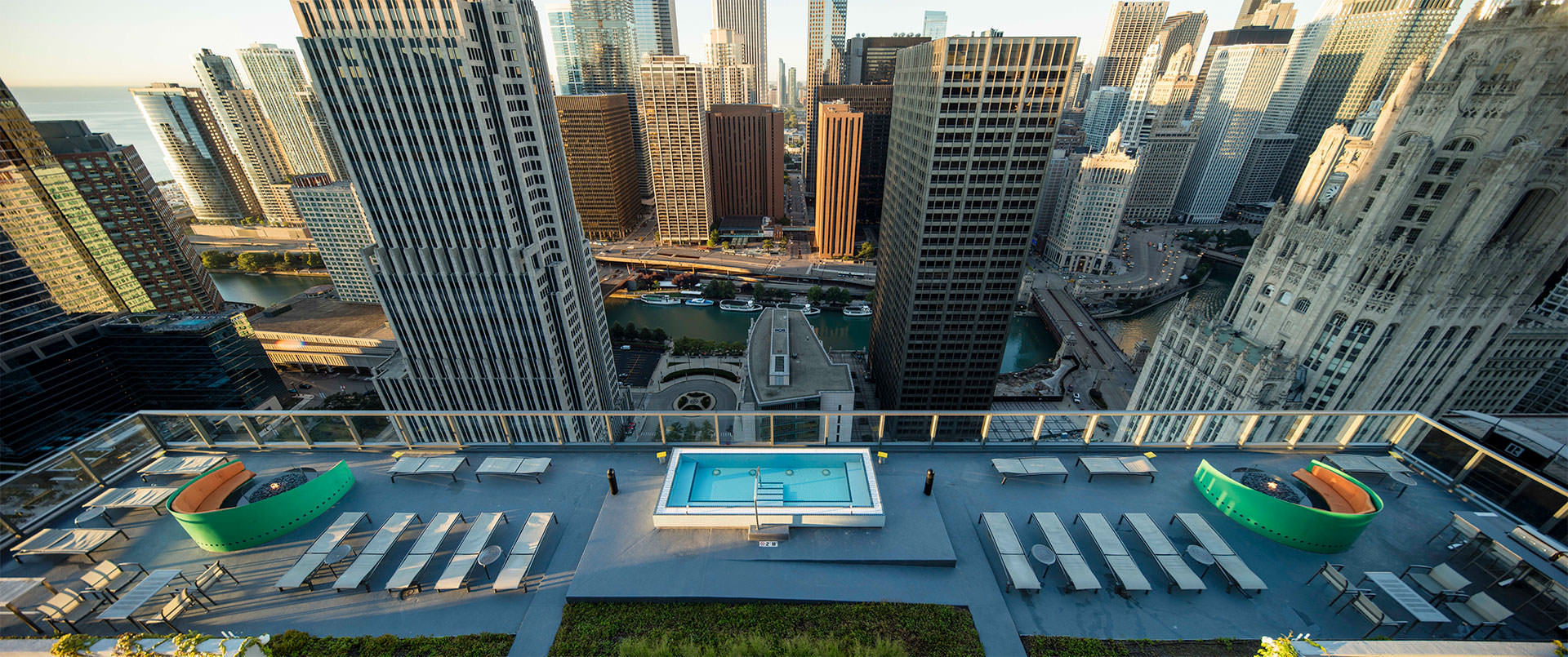 A bird's eye view of the patio shows that it overlooks many Chicago skyscrapers and the Chicago River.