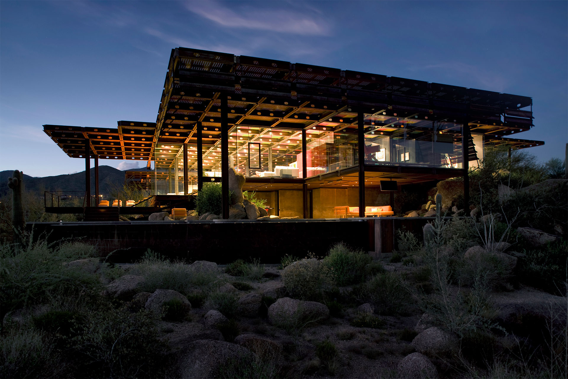 View of the house within the desert at night