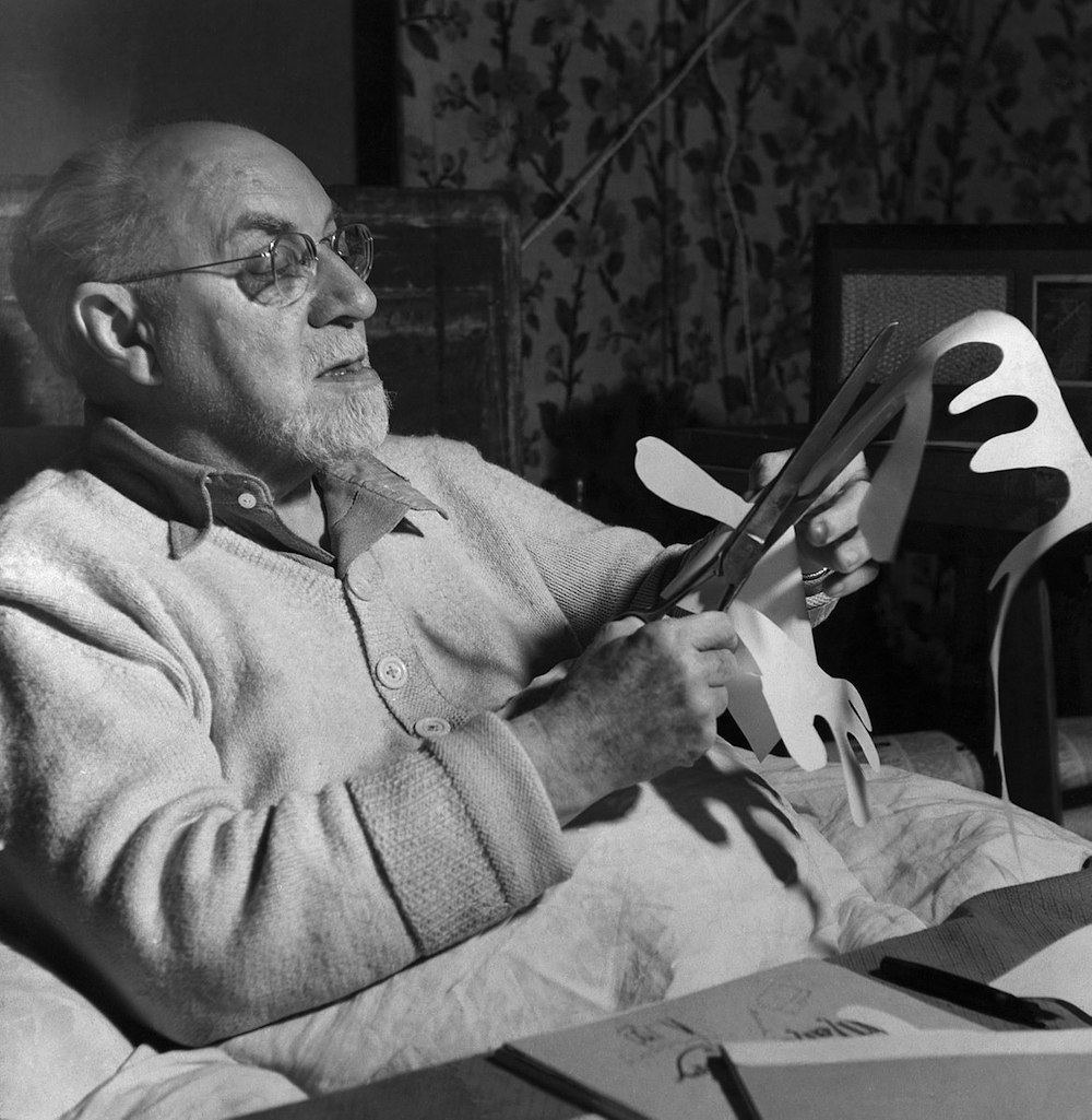 Henri Matisse working on a cut paper collage, a preferred medium in his later years after falling ill.