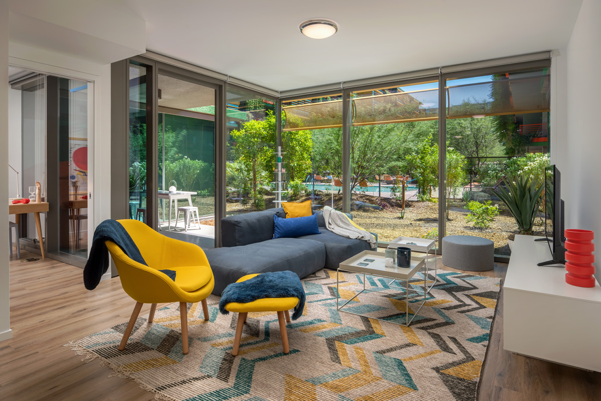 Colorful modernist furniture and courtyard view at Optima Sonoran Village