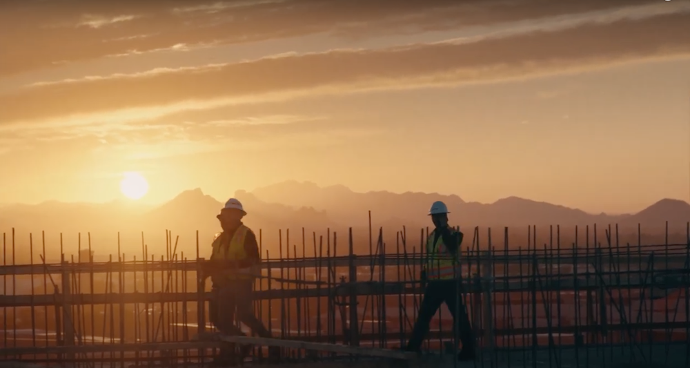 Construction crew on site at dawn