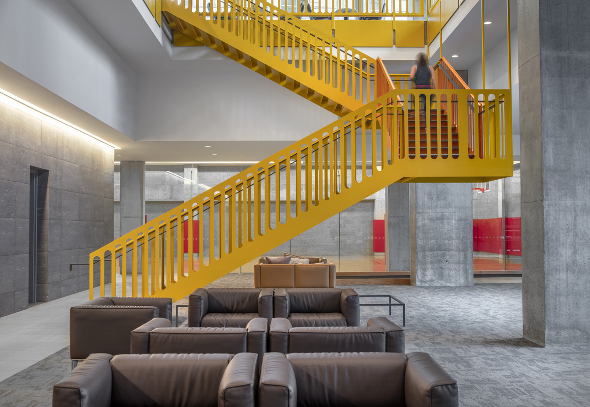Yellow stairs connecting the amenity floors at Optima Signature