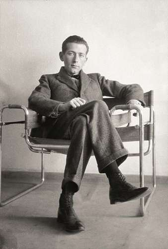 Marcel Breuer sitting in a Wassily Chair. Image courtesy of Britannica
