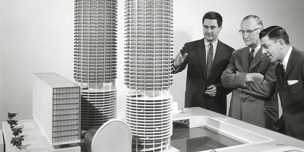 Bertrand Goldberg presenting a model of Marina City; photo courtesy of BertrandGoldberg.org