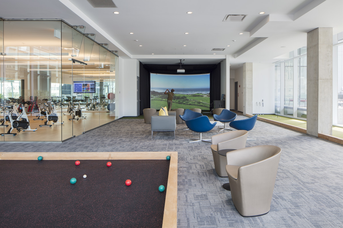 Golfing Simulator on the 7th floor amenity space at Optima Signature