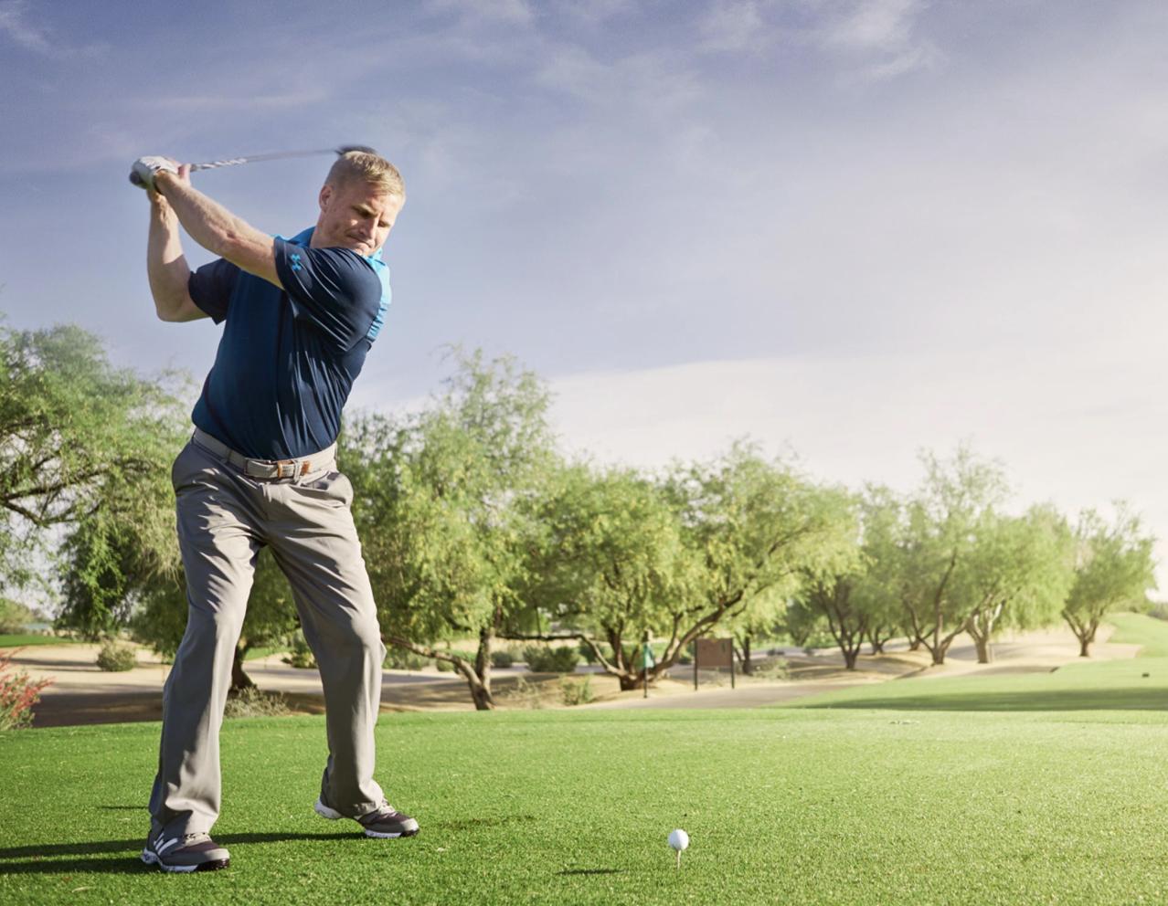 A man tees up to hit a golf ball