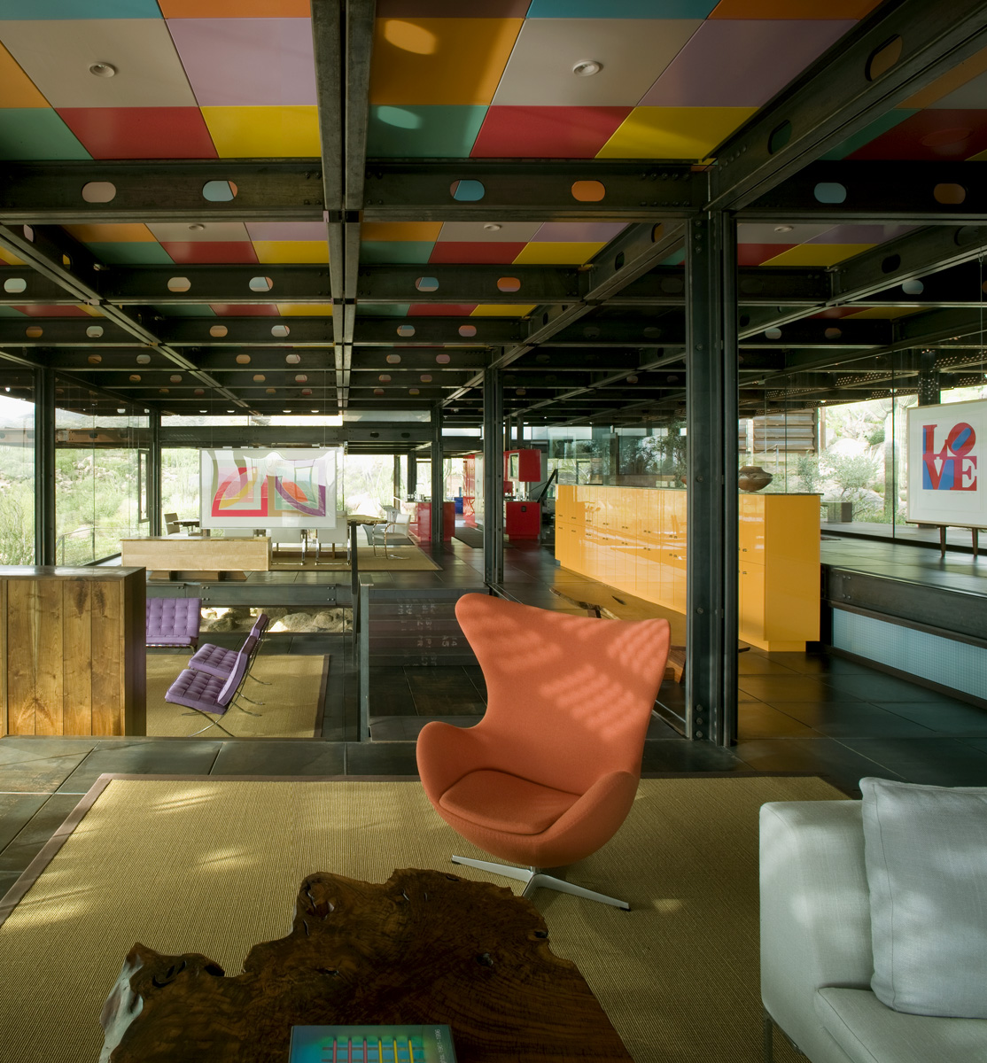 The open floor design of Relic Rock is presented with colorful furniture, ceilings and rugs.