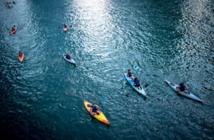 A group of kayaks floating down a body of water