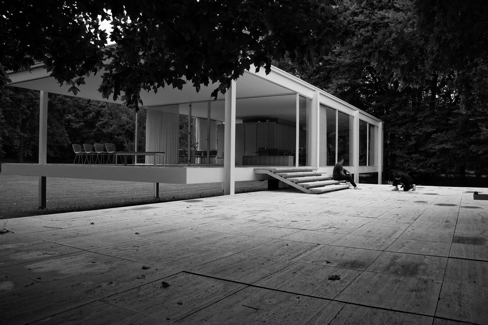The exterior of a modern mid-century home is photographed in black and white.