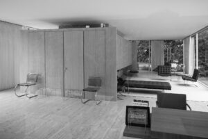 A black and white photo illuminates the interior of a modern mid-century style home.
